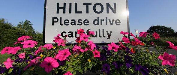 welcome to Hilton sign with floral display